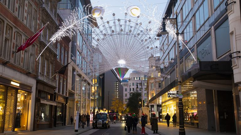 LONDON, ENGLAND - NOVEMBER 22: A view of Peacock Christmas lights illuminating New Bond Street during the second major lockdown of the coronavirus pandemic on November 22, 2020 in London, England. The UK Prime Minister is expected to announce further relaxed restrictions around the Christmas holiday after the national lockdown ends on 2 December. (Photo by Jo Hale/Getty Images)