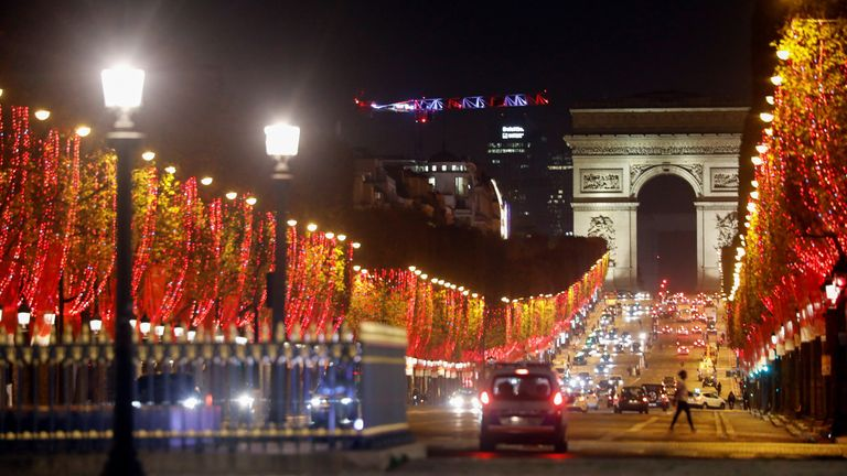The Champs Elysees lit up in Paris, France