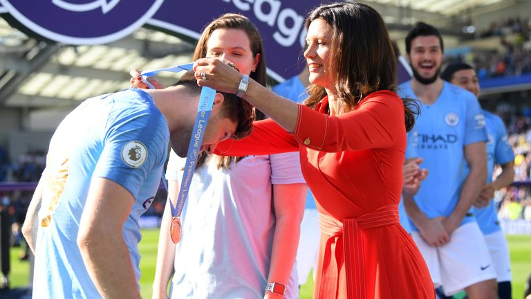 Claudia Arney is seen here awarding Manchester City players their Premier League winners' medals in 2019