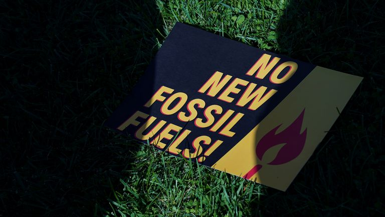 A sign protesting fossil fuels is seen on the lawn outside of the U.S. Capitol in Washington, U.S., October 18, 2019. REUTERS/Sarah Silbiger