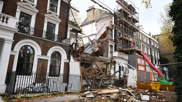 The scene in Durham Place in Chelsea, west London, after two mid-terrace houses collapsed. The two properties, which were undergoing renovation work, collapsed late on Monday evening, causing emergency services to evacuate nearby homes. Nobody was thought to be hurt, according to the London Fire Brigade.