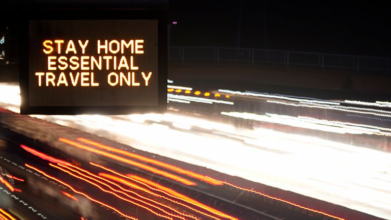 In this long exposure photograph, an electronic matrix sign informs motorists on the M6 in Cheshire 'Stay Home Essential Travel Only' on November 11, 2020