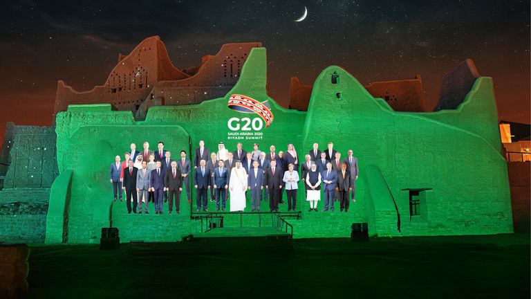Because of COVID restrictions, a virtual 'family photo' of the leaders was created and projected onto the Salwa Palace in At-Turaif, one of Saudi Arabia's UNESCO World Heritage sites. Credit Diriyah Gate Development Authority