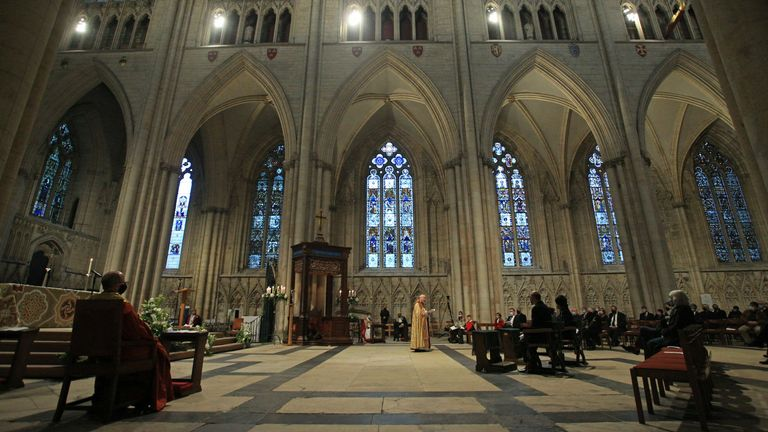 The Most Reverend Stephen Cottrell (C), the 98th Archbishop of York, takes a service of evensong at York Minster in northern England on October 18, 2020