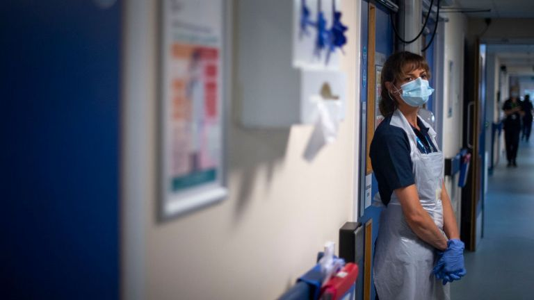 A support worker stands in a corridor as the first patients are admitted to the NHS Seacole Centre at Headley Court, Surrey on May 28, 2020, a disused military hospital, which has been converted during the novel coronavirus COVID-19 pandemic. - Named in honour of Jamaican born nurse, Mary Seacole, the facility will help care for and support patients recovering from COVID-19