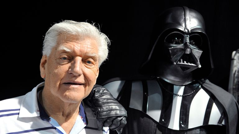 English actor David Prowse (L), who played the character of Darth Vader (Dark Vador in French) in the first Star Wars trilogy poses with a fan dressed up in a Darth Vader costume during a Star Wars convention on April 27, 2013 in Cusset. AFP PHOTO THIERRY ZOCCOLAN (Photo credit should read THIERRY ZOCCOLAN/AFP via Getty Images)
