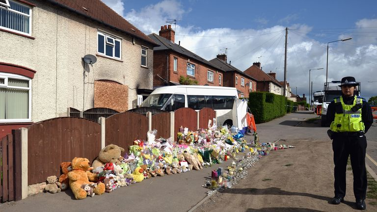 """Floral tributes adorn the pavement outside a house in Allerton after a fire claimed the lives of six children on May 14, 2012 in Derby, England. Duwayne Philpott, aged 13 his sister Jade, 10, and brothers John, nine, Jack, seven, Jessie, six, and Jayden, five died in the fire which started in the early hours of last Friday. The children's father Mick Philpott, who is believed to have 17 children has been praised for his """"valiant attempts"""" to save them..."""