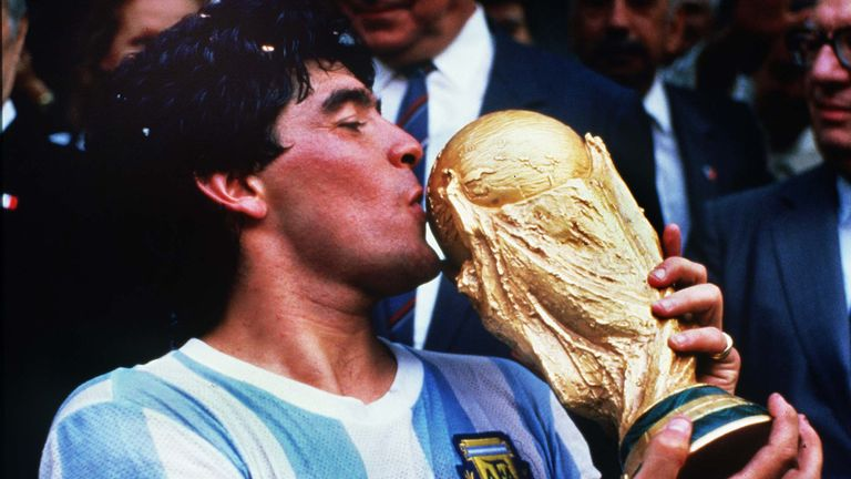 Diego Maradona kisses the World Cup after Argentina beat  West Germany in 1986