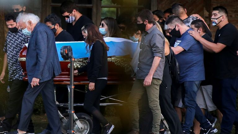 Friends and family carry the casket of the football legend