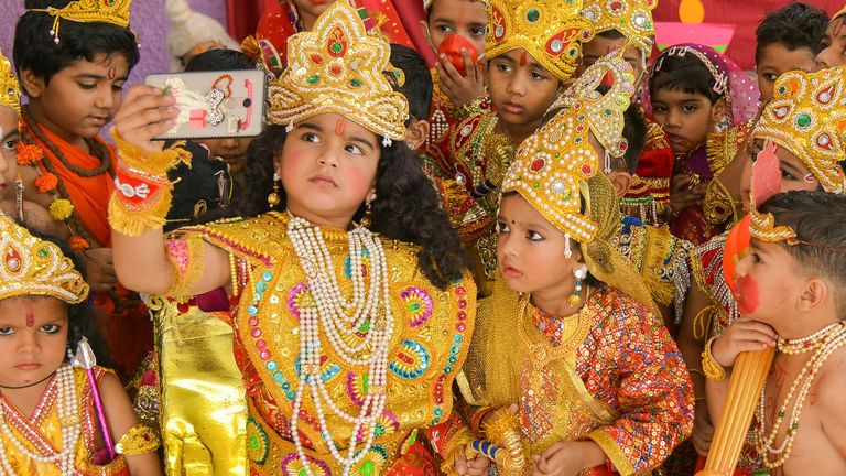 Indian children celebrating Diwali by dressing up as Hindu deities, and of course taking a selfie