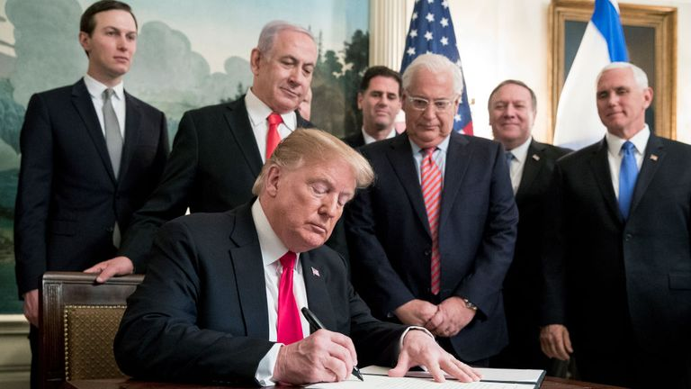WASHINGTON, DC - MARCH 25: (AFP OUT) US President Donald J. Trump (C) signs an order recognizing Golan Heights as Israeli territory, in front of Prime Minister of Israel Benjamin Netanyahu (Back C), in the Diplomatic Reception Room of the White House March 25, 2019 in Washington, DC.
