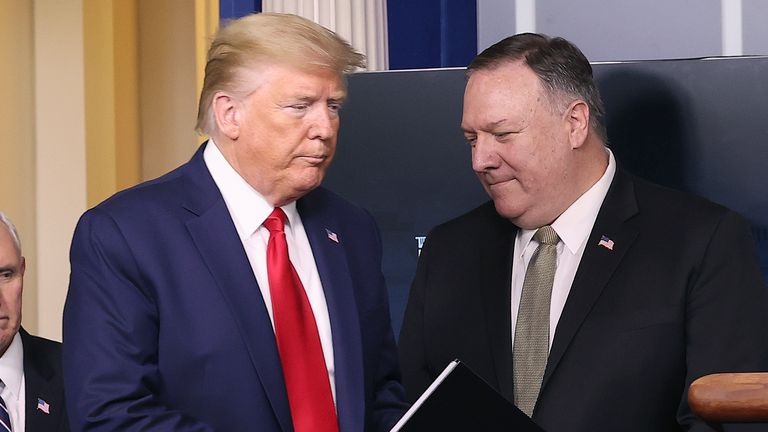 Donald Trump with Mike Pompeo in April