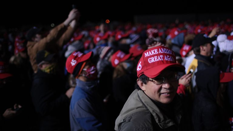 KENOSHA, WISCONSIN - NOVEMBER 02: Supporters listen as President Donald Trump speaks during a campaign rally at the Kenosha Regional Airport on November 02, 2020 in Kenosha, Wisconsin. Trump, who won Wisconsin with less than 1 percent of the vote in 2016, currently trails former vice president and Democratic presidential candidate Joe Biden in the state according to recent polls. (Photo by Scott Olson/Getty Images)