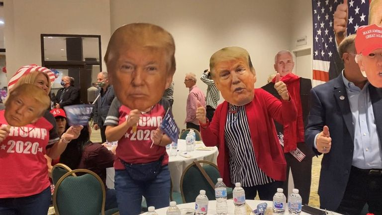 Republicans wear Donald Trump face masks at a party in Palm Beach