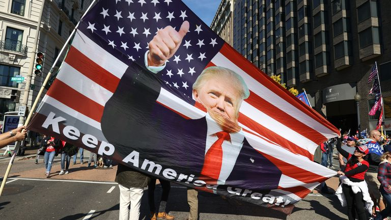 Protesters waved American flags in support of Donald Trump