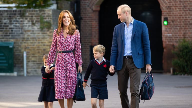 Princess Charlotte hides behind her mother the Duchess of Cambridge as she arrives for her first day of school at Thomas's Battersea in London, accompanied by her brother Prince George and her father the Duke of Cambridge. PA Photo. Picture date: Thursday September 5, 2019. See PA story ROYAL Charlotte. Photo credit should read: Aaron Chown/PA Wire