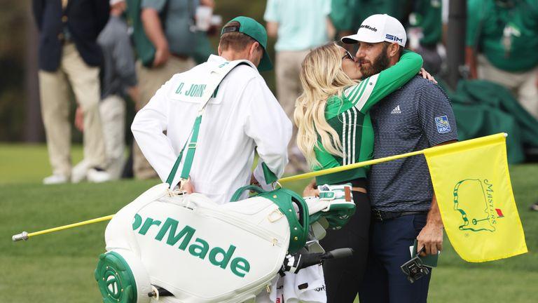 Dustin Johnson's fiancee Paulina Gretzky gave him a kiss after he won