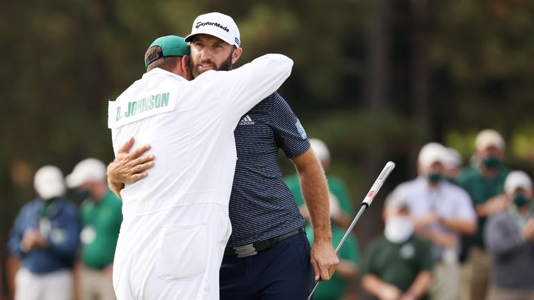 Johnson's brother and caddie, Austin, gave him a big hug as he putted the winning shot