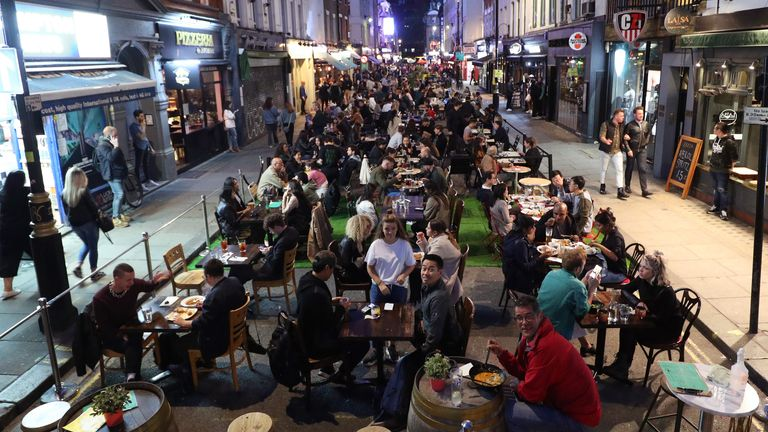 People eating on restaurant tables in Soho as Eat Out to Help Out came to end in August