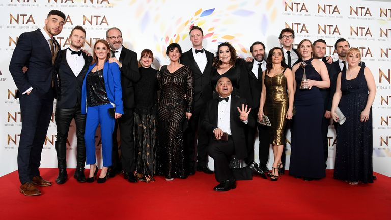 "LONDON, ENGLAND - JANUARY 28: Cast members including Jurell Carter, Matthew Wolfenden, Natalie J. Robb, Jonny McPherson, Bhasker Patel, Lisa Riley, Rebecca Sarker, Mark Charnock, Danny Miller and Jonathan Wrather, accepting the Serial Drama award for ""Emmerdale"", pose in the winners room during the National Television Awards 2020 at The O2 Arena on January 28, 2020 in London, England. (Photo by Gareth Cattermole/Getty Images)"