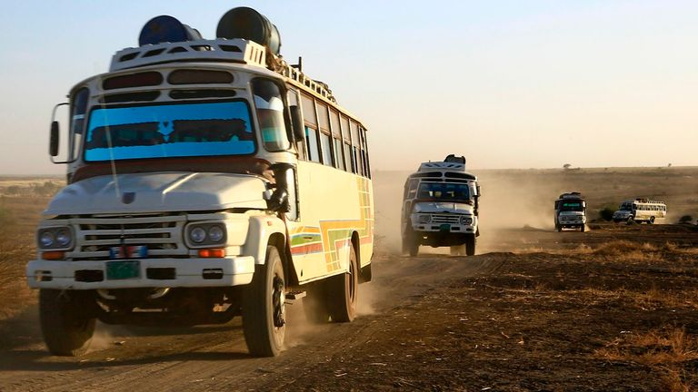 Buses take Ethiopian refugees to a camp inside Sudan