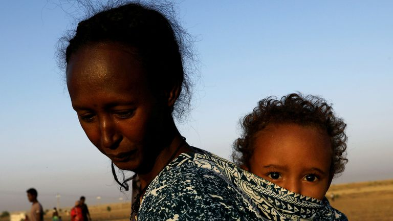 An Ethiopian woman with her child near the Setit river on the border with Sudan