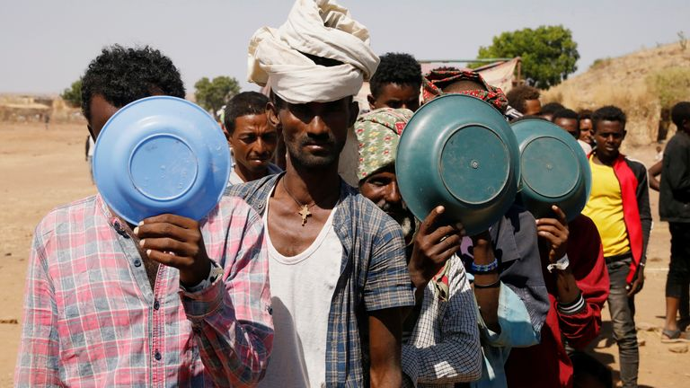 Ethiopian refugees wait in line for a meal at the Um Rakuba refugee camp, on the Sudan-Ethiopia border