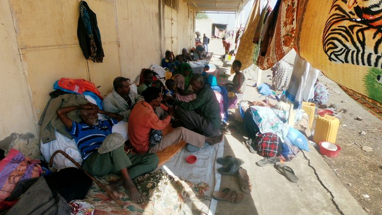 Ethiopians who fled the ongoing fighting in Tigray region sit with their belongings in Hamdait village on the Sudan-Ethiopia border in eastern Kassala state, Sudan November 14, 2020. REUTERS/El Tayeb Siddig