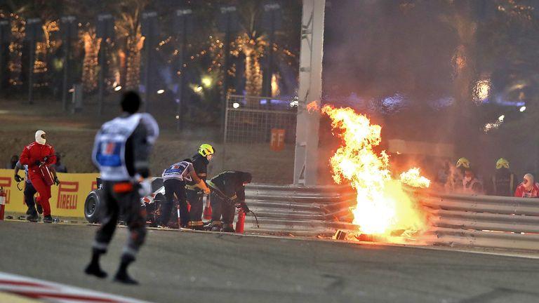 TOPSHOT - Haas F1's French driver Romain Grosjean's car burns after crashing during the Bahrain Formula One Grand Prix at the Bahrain International Circuit in the city of Sakhir on November 29, 2020. (Photo by KAMRAN JEBREILI / POOL / AFP) (Photo by KAMRAN JEBREILI/POOL/AFP via Getty Images)