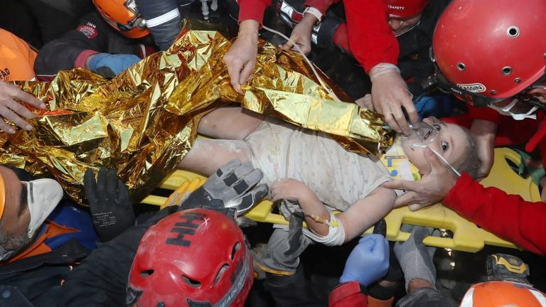 Rescue workers carry a 4-year-old girl, Ayla Gezgin, out from a collapsed building after an earthquake in the Aegean port city of Izmir, Turkey November 3, 2020. Turkey's Disaster and Emergency Management Presidency (AFAD)/Handout via REUTERS ATTENTION EDITORS - THIS PICTURE WAS PROVIDED BY A THIRD PARTY. NO RESALES. NO ARCHIVE.