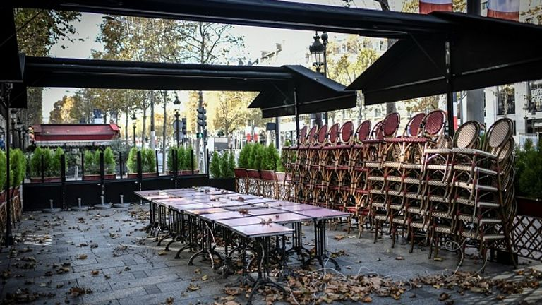 The Champs-Elysees is largely deserted as restaurants and cafes across the country are shut