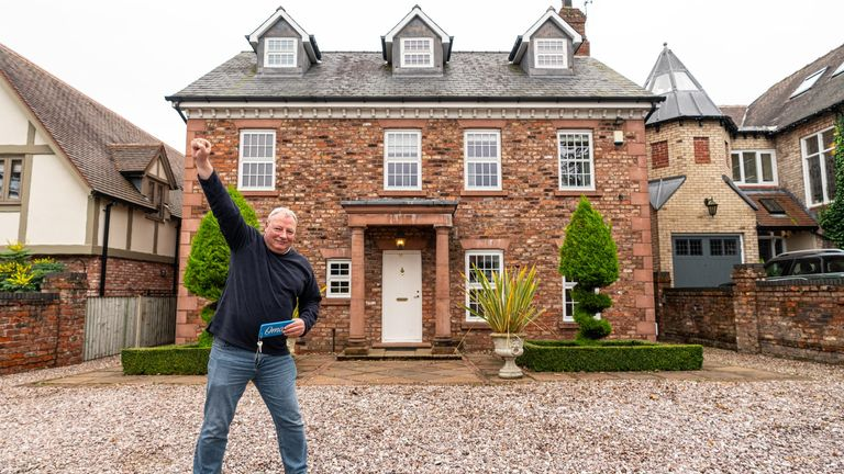 Undated handout photo issued by Omaze of Ian Garrick, a civil servant from Mablethorpe, Lincolnshire, outside the £1 million pound house in Cheadle Hulme, Cheshire he won as part of a charity draw in aid of Teenage Cancer Trust.