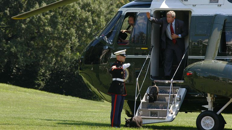 WASHINGTON - AUGUST 13: U.S. President George W. Bush disembarks Marine One as he arrives on the South Lawn of the White House with his dogs, Barney and Miss Beazley, August 13, 2006 in Washington, DC. Bush returned to Washington after vacationing at his ranch in Crawford, Texas. (Photo by Evan Sisley-Pool/Getty Images)