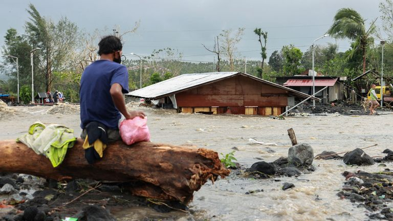 Typhoon Goni aftermath in Albay province A man looks at his house buried under the pile of rubble and sand following flash floods brought by Typhoon 'Goni' in Barangay Busay, Daraga town, Albay province, Philippines, November 1, 2020. REUTERS/Nino N. Luces NO RESALES. NO ARCHIVES