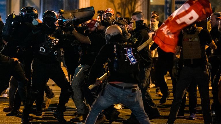 Groups of Antifa and Proud Boys clash in the middle of the street following the Million MAGA March