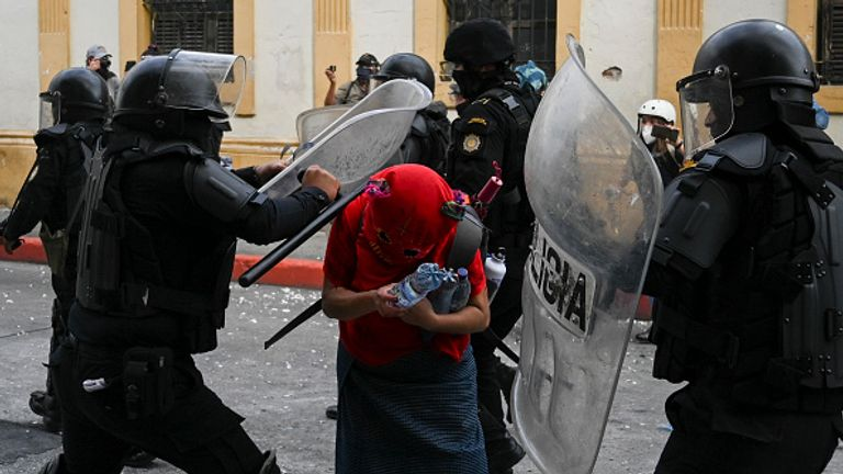 Riot police appear to attack a demonstrator in Guatemala City