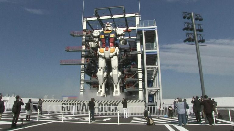 """""""Gundam"""" - a giant robot from an iconic Japanese anime strolled to life at a theme park site set to open officially on Dec 19."""