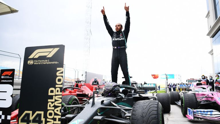 Lewis Hamilton celebrates after winning his seventh world title