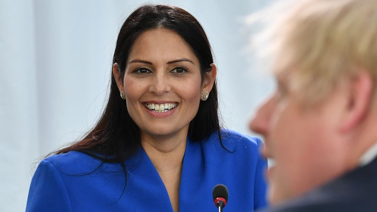 Home Secretary Priti Patel (L) looks on Britain's Prime Minister Boris Johnson chairs a cabinet meeting at the National Glass Centre at the University of Sunderland on January 31, 2020