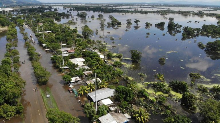 A community road leading to Puerto Cortes in Honduras is seen after it was flooded