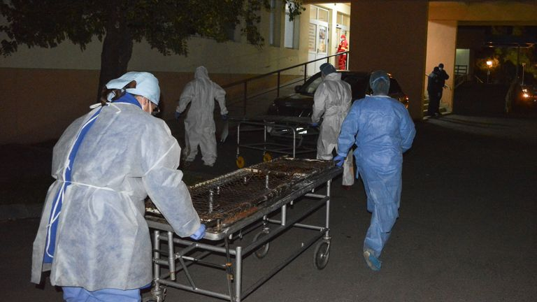 Medical staff rush to move patients after the blaze broke out
