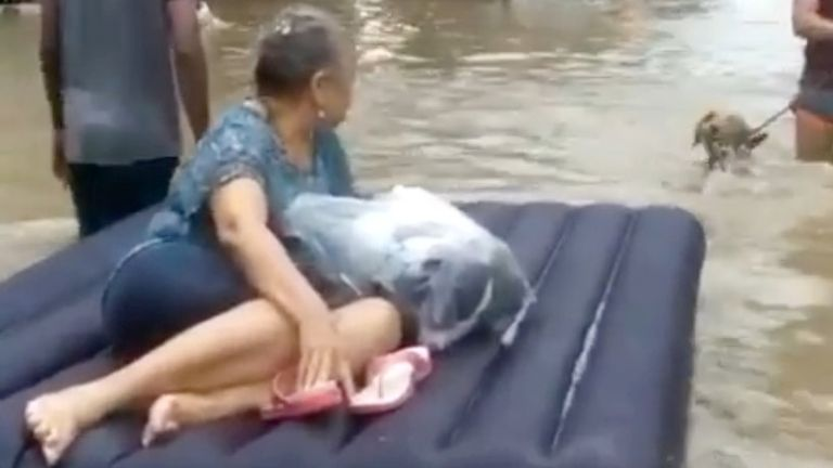 A woman is evacuated on a raft amid floodwaters caused by Hurricane Iota in Cartagena, Colombia. Pic: Luis Guillermo Ferrebus/via Reuters