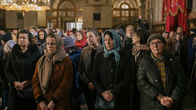Orthodox believers attend the liturgy of the late Serbian Patriarch Irinej during his funeral service