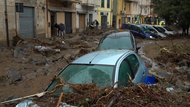 Still image taken from video shows cars submerged by debris after heavy rainfall flooded the town of Bitti, Italy November 28, 2020. Local Team/Reuters TV via REUTERS ATTENTION EDITORS - ITALY OUT. NO COMMERCIAL OR EDITORIAL SALES IN ITALY AND .IT WEBSITES. THIS IMAGE HAS BEEN SUPPLIED BY A THIRD PARTY.