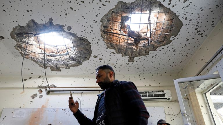 Afghan journalists film inside a class after yesterday's attack at the university of Kabul, Afghanistan November 3, 2020. REUTERS/Mohammad Ismail