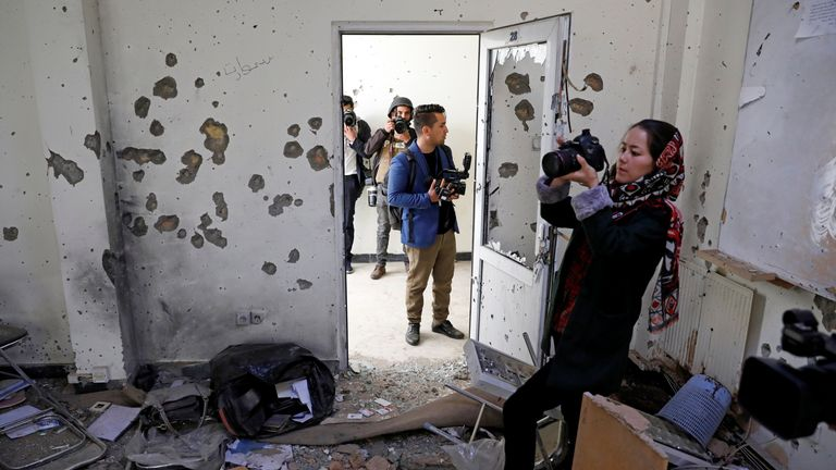 Afghan journalists film inside a classroom after yesterday's attack at the university of Kabul, Afghanistan November 3, 2020. REUTERS/Mohammad Ismail