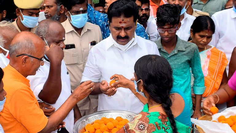 "Residents distributes sweets as they celebrate the victory of US Democratic Vice President-Elect Kamala Harris, at her ancestral village of Thulasendrapuram in the southern Indian state of Tamil Nadu on November 8, 2020. - Residents set off firecrackers in the ancestral home of Kamala Harris on November 8 as India celebrated the vice president-elect's victory in the US election, as others hailed her achievement as historic and a ""proud moment"" for the country. (Photo by STR / AFP) (Photo by STR/"