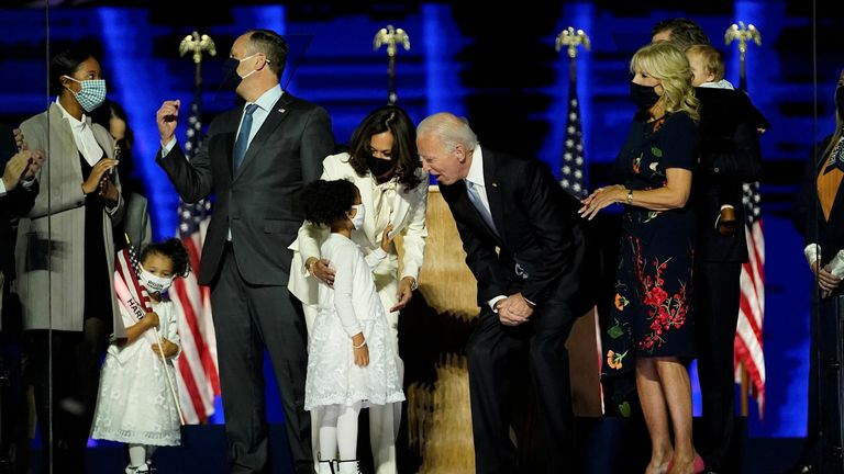 WILMINGTON, DELAWARE - NOVEMBER 07: President-elect Joe Biden and Vice President-elect Kamala Harris interact with their family members after addressing the nation from the Chase Center November 07, 2020 in Wilmington, Delaware. After four days of counting the high volume of mail-in ballots in key battleground states due to the coronavirus pandemic, the race was called for Biden after a contentious election battle against incumbent Republican President Donald Trump. (Photo by Andrew Harnik-Pool/