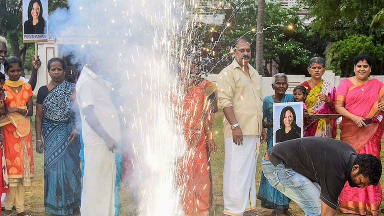 "Residents hold placards with the portrait of US Democratic Vice President-Elect Kamala Harris, as they celebrate her victory in the US election, at her ancestral village of Thulasendrapuram in the southern Indian state of Tamil Nadu on November 8, 2020. - Residents set off firecrackers in the ancestral home of Kamala Harris on November 8 as India celebrated the vice president-elect's victory in the US election, as others hailed her achievement as historic and a ""proud moment"" for the country. (P"