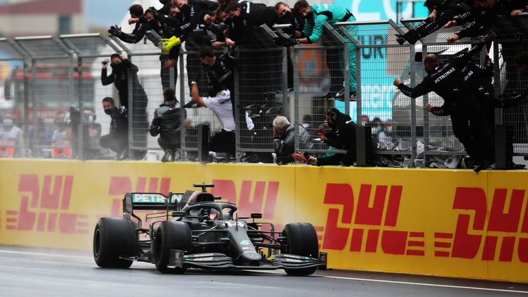 Mercedes team members celebrate as Lewis Hamilton wins his seventh world title